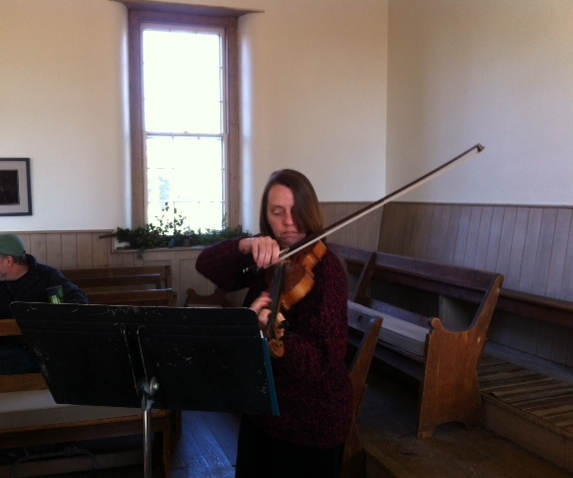 One of our members playing Christmas songs on her fiddle